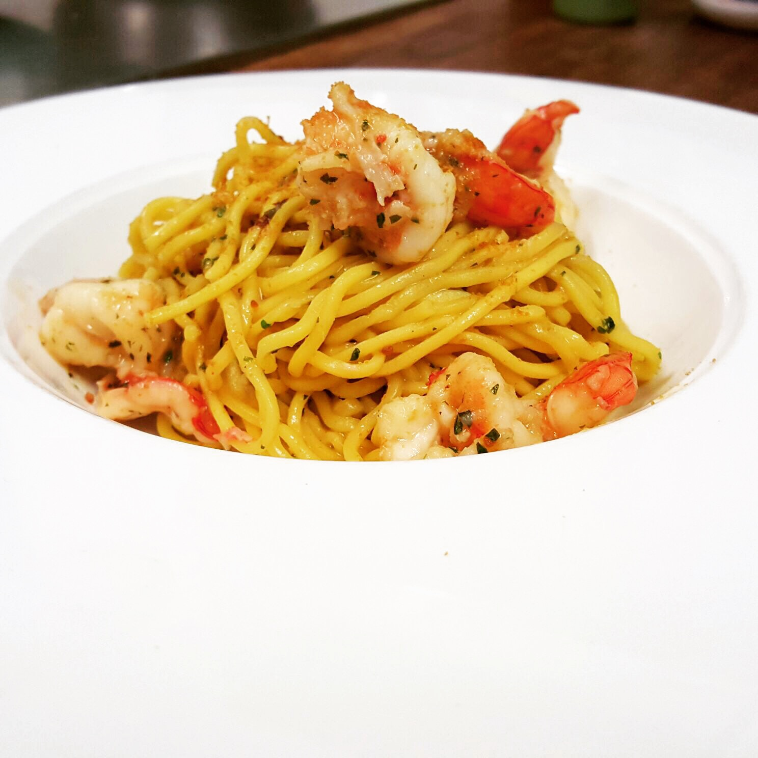 Homemade tagliolini with lemon, prawns and bottarga
