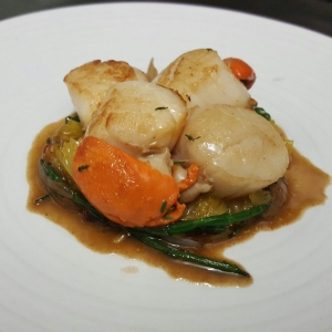 Scallops, orange and samphire