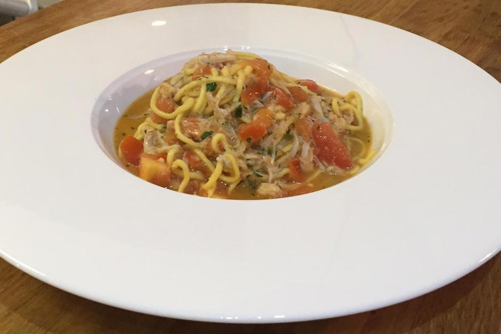 Tagliolini with fresh crab, tomatoes and chilli